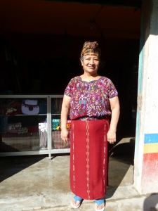 shop keeper in Nebaj Guatemala models her traje (suit).