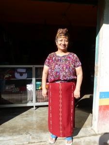 shop keeper in Nebaj Guatemala models her traje (suit).