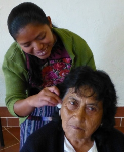 Mayan Health Promoter applies NADA protocol at Mediacal Workshop in Guatemalan Highlands